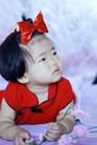 Innocent Chinese little baby in red cheongsam Royalty Free Stock Photo