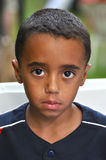 Innocent Eyes. Beautiful portrait of little boy with big eyes. His eyes are intense and innocent Stock Photos