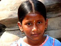 Innocent Girl. A innocent Indian girl poses for a picture stock image