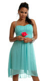 Innocent Girl. An innocent looking woman with a rose royalty free stock photos