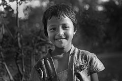 Innocent Girl. A rural girl smile with innocently at the village of West Bengal-India Royalty Free Stock Photo