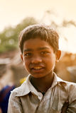 Innocent happy indian poor child. Innocent Smile of indian poor child in playground and small fly near nose Stock Photography