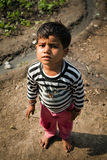 Innocent indian child. Innocent  indian child in playground in sunlight noon Stock Photography