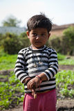 Innocent  of indian child. Innocent  indian child in playground in sunlight noon Royalty Free Stock Photo
