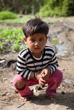 Innocent  indian child. In playground in sunlight noon Stock Images
