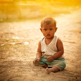Innocent indian child. In playground in sunlight evening royalty free stock photography