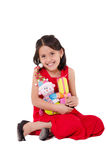 Innocent little girl playing with a doll Stock Photos
