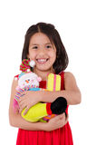Innocent little girl playing with a doll Royalty Free Stock Photo