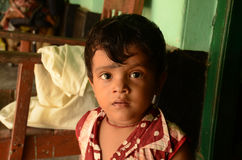 Innocent Look. A little boy looking innocently Royalty Free Stock Image