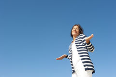 Innocent mature woman sky background Royalty Free Stock Images