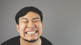 Innocent smile. An asian guy with black t-shirt stock photography