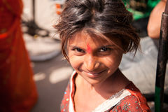 Innocent smile of indian female child. In market during noon Royalty Free Stock Photos