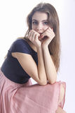 Innocent teenager girl looking shy with hands near her face Royalty Free Stock Images