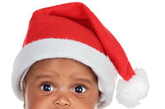 Innocent watched. Of Adorable Santa Baby a over white background royalty free stock photo