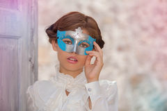 Innocent woman with face masquerade mask stock photography