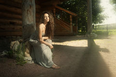 Innocent woman with flying curly hair. Young beautiful innocent woman with flying curly hair outdoor royalty free stock images