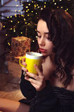 Innocent young brunet woman waiting a Christmas Royalty Free Stock Photos