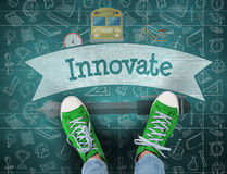 Innovate against green chalkboard Royalty Free Stock Images