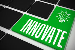 Innovate on black keyboard with green key Royalty Free Stock Photo