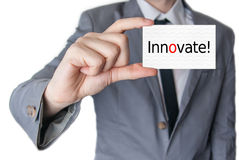 Innovate. Businessman holding business card Royalty Free Stock Photo