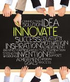 Innovate. Photo of business hands holding blackboard and writing INNOVATE stock photography