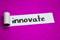 Innovate text, Inspiration, Motivation and business concept on purple torn paper royalty free stock image