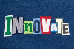 INNOVATE text word collage colorful fabric on denim, creative thinking. Horizontal aspect stock photo
