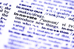 Innovate word. Close-up of the word innovate  in a dictionary. Blue tone Royalty Free Stock Photo