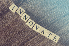 Innovate word formed with wooden blocks Royalty Free Stock Image