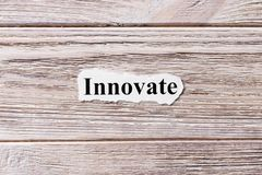Innovate of the word on paper. concept. Words of Innovate on a wooden background.  stock photography