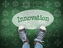 Innovation against green chalkboard Stock Image