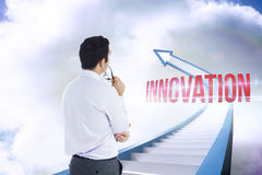Innovation against red staircase arrow pointing up against sky Royalty Free Stock Image
