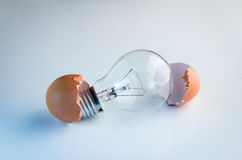 Innovation Bright Ideas Light Bulb Hatching From Egg Shell. On white floor Royalty Free Stock Photos