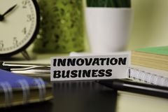 Innovation Business on the paper isolated on it desk. Business and inspiration concept royalty free stock photography