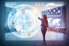 Innovation concept. Back view of young woman pressing abstract buttons on digital business hologram in interior with night city view. Innovation concept. Double Stock Photography