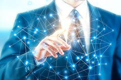 Innovation concept. Businessman pointing at abstract polygonal connection hologram. Innovation concept Royalty Free Stock Photo
