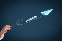 Innovation. Concept. Businessman throw a paper plane symbolizing acceleration and Stock Photos