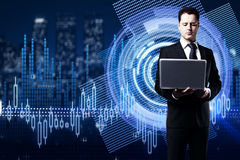 Innovation concept. Businessman using laptop on abstract digital business chart hologram hologram with city view. Innovation concept. 3D Rendering Stock Photography