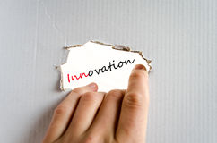 Innovation Concept. Hand on the cardboard background innovation concept Royalty Free Stock Image