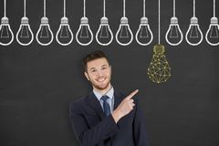 Innovation concepts with light bulbs on a chalkboard background. Working Stock Photography