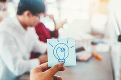 Innovation Creativity inspiration ideas ,Team creative business planning and thinking of new ideas for success work project in. Cafe royalty free stock images