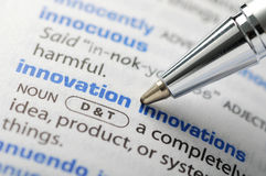 Innovation. Fountain pen pointing innovation word; abstract report tax season stock images