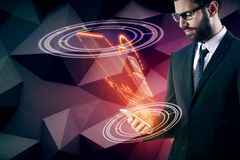 Innovation and future concept. Side view of handsome young businessman holding smartphone with abstract digital teleport on polygonal wall background. Innovation Royalty Free Stock Photos