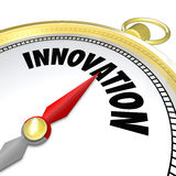 Innovation Gold Compass Points to New Change. The word Innovation on a gold compass symbolizing new changes, progress, future advancement and advanced technology Royalty Free Stock Images