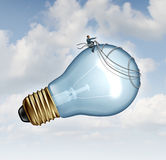 Innovation Guidance. Business concept and creative inspiration with strategic leadership imagination of new ideas as a businessman guiding a giant light bulb Stock Image