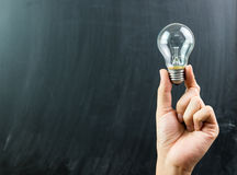 Innovation with hand hold light bulb Royalty Free Stock Photo