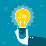 Innovation - hand with shining light bulb Stock Photos