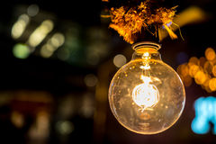 Innovation and illumination light bulb inspiration with bokehs Royalty Free Stock Image