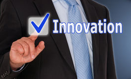 Innovation - Manager with touchscreen button royalty free stock photography