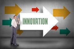 Innovation mot att peka för pilar Arkivbild